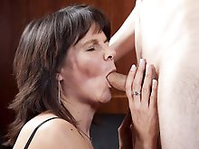 Alluring mature mama playing alone
