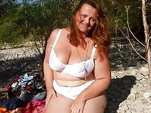 Shocking mature mistress posing undressed in public