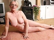 Fresh mature businesswoman is spreading pussy